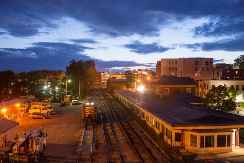 train station in Charlottesville at sunset with a train coming in on the tracks